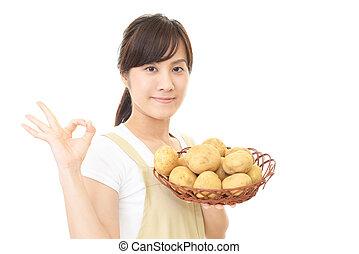 Woman holding potatoes