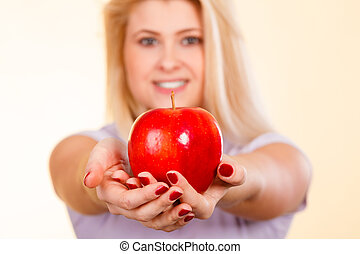 Woman holding red apple, healthy food concept