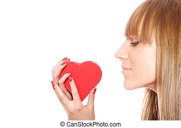 Woman holding red heart in the hand