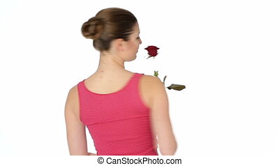 woman holding red rose and smiling on a white background.
