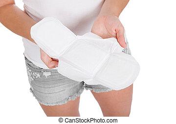 Woman holding Sanitary pad - Closeup of woman holding ...