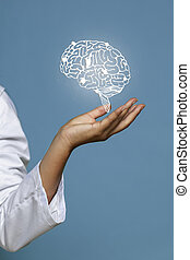 Woman holding shiny brain hologram