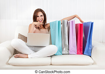 Woman Holding Shopping Bag At Home