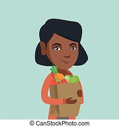 Woman holding shopping bag with healthy food.