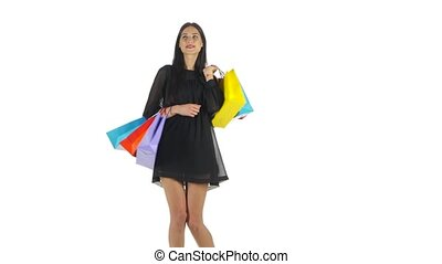 Woman holding shopping bags,. White