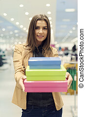 Woman holding shopping boxes