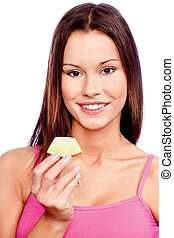 woman holding slice of melon