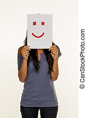 woman holding smiley face before