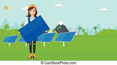 Woman holding solar panel. - Woman holding a solar panel in...