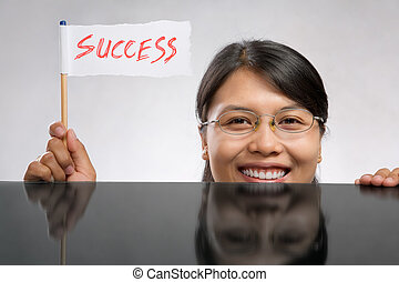 Woman holding success flag