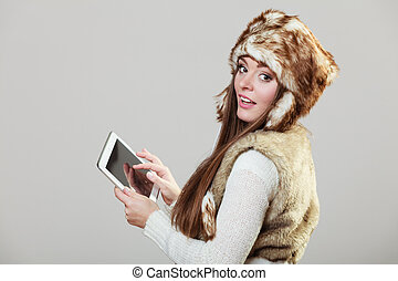 Woman holding tablet computer