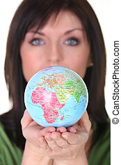 woman holding the globe