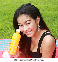 Woman holding the orange juice.
