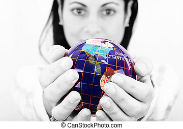 woman holding the world in her hands