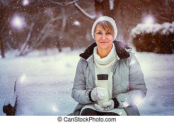 Woman holding thermal mug