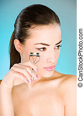 woman holding tool for eyelash