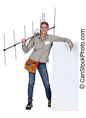 Woman holding TV antenna with white sign
