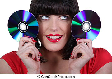 Woman holding two Cd's