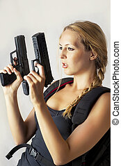 woman holding two hand gun