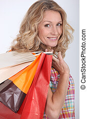 Woman holding two shopping bags