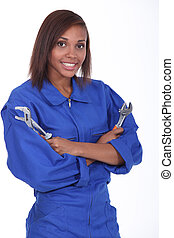Woman holding two spanners