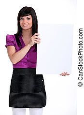 Woman holding up a blank board