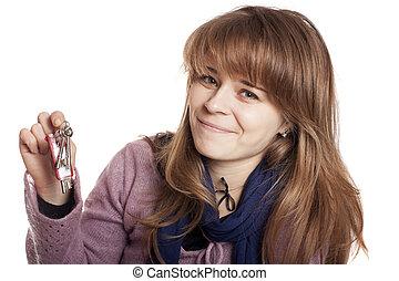 Woman holding up a set of keys