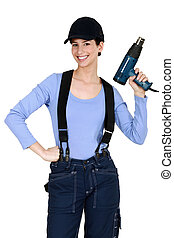 Woman holding up an electric screwdriver