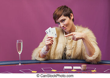 Woman holding up cards