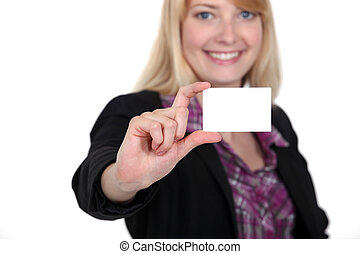 Woman holding up her business card