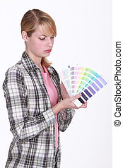 Woman holding up paint samples