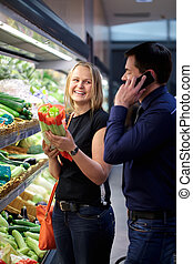 Woman holding vegetables smiling
