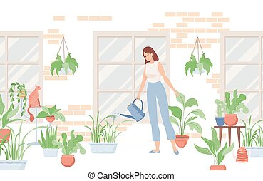 Woman holding watering can and watering home plants near the house or in the room.