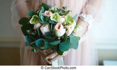 Woman holding wedding bouquet