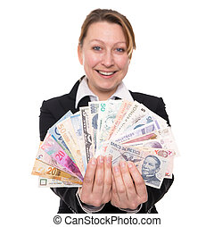 woman holding widely traded currencies