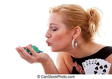 Woman holding winning cards