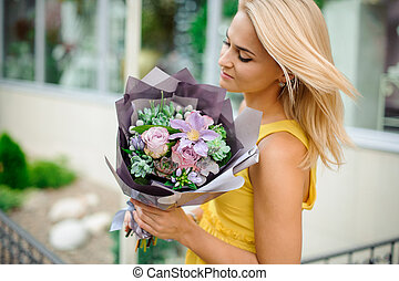 woman holds a bouquet of rose flowers, echeveria, brunia, succulents