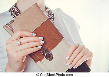 Woman holds a clutch
