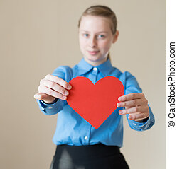 woman holds a heart in his hands