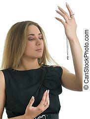 woman holds a jewelery chain