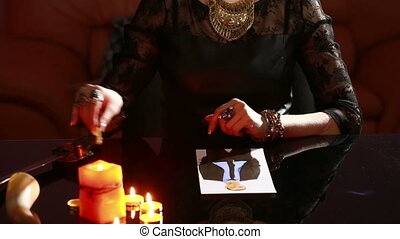woman holds a ritual of black magic. spell men. He uses...