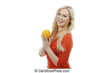 Woman holds an orange fruit