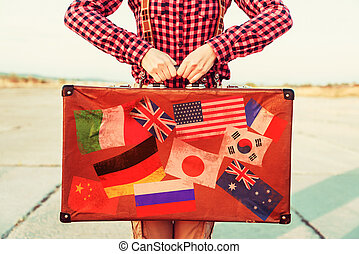 Suitcase with stamps flags