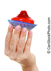 Woman holds cake strawberry cupcake in hand