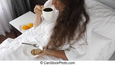 Woman holds cup coffee to her lips - Pretty woman morning...