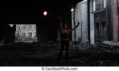 Woman holds in his hand the fire