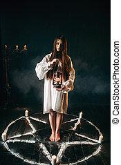 Woman holds kerosene lamp, pentagram circle, magic