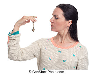 woman holds keys in a hand