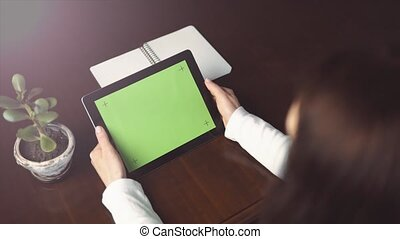Woman Holds Tablet Pc with Green Screen - Indoor shot of a...