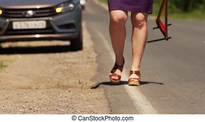 Woman Holds Warning Sign And Sets It Near The Car - Woman...